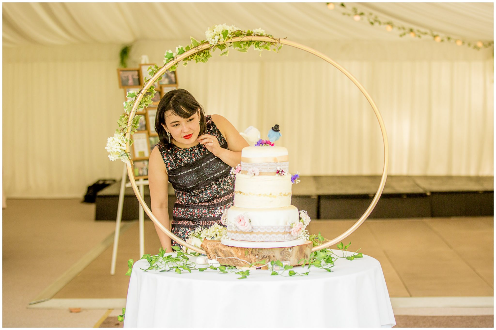 A guest checks out the wedding cake, designed and made by the bride