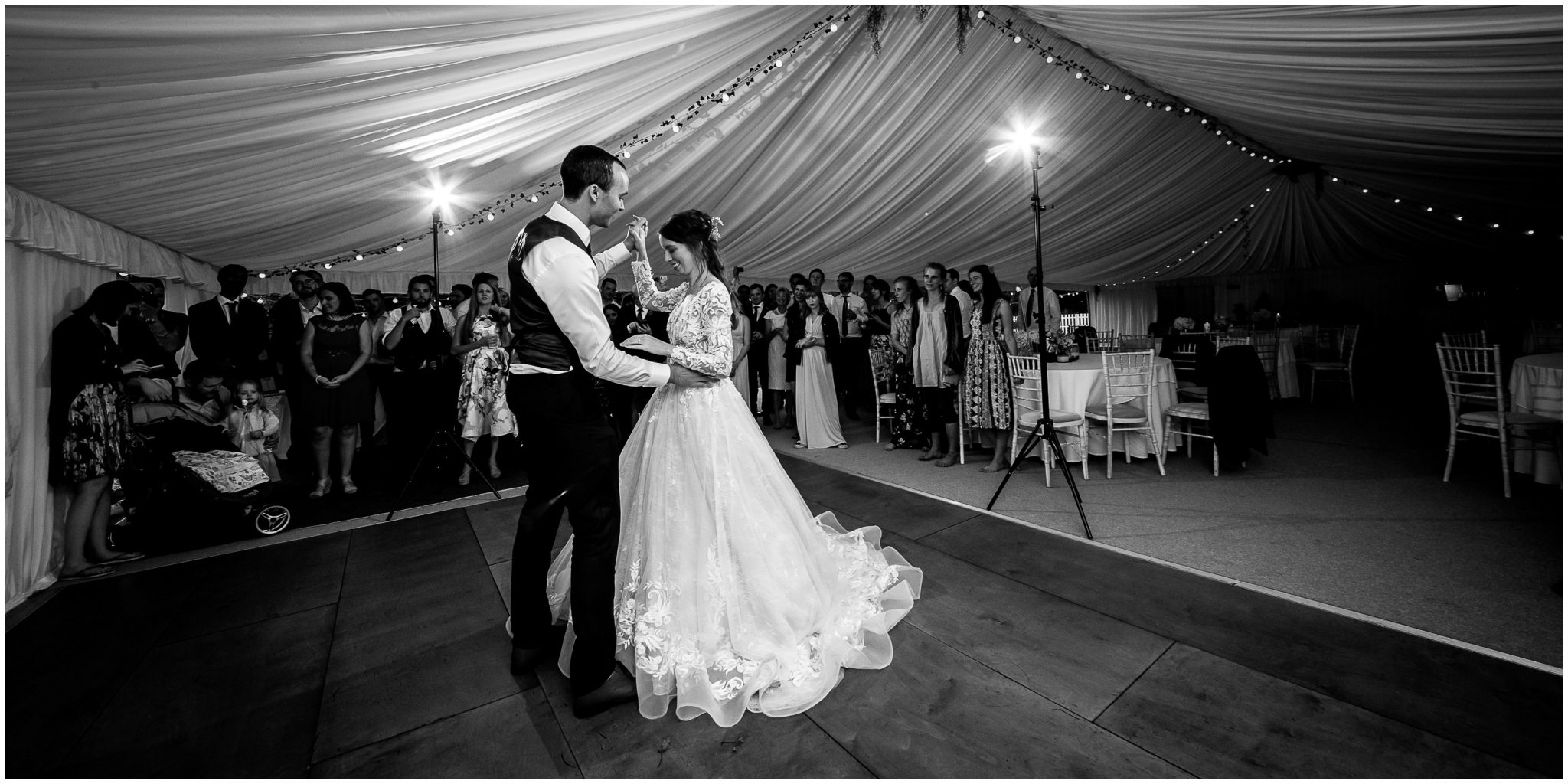 Couple first dance in marquee