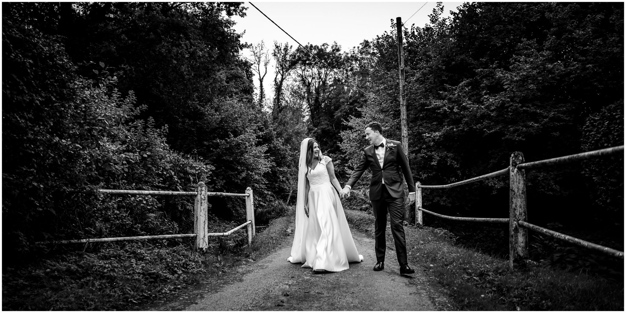 The couple walk along a country lane