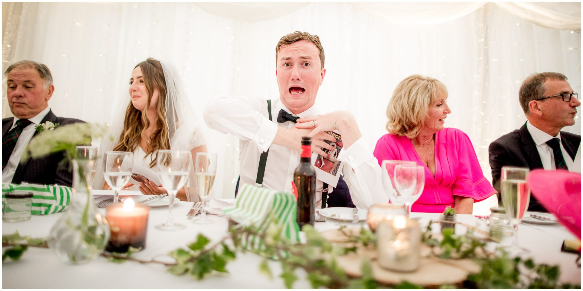 Groom reaction to the best man's speech as the props come out