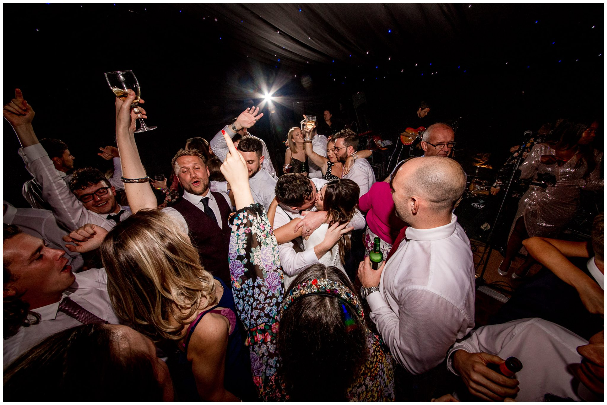 Bride and groom kissing on the dancefloor
