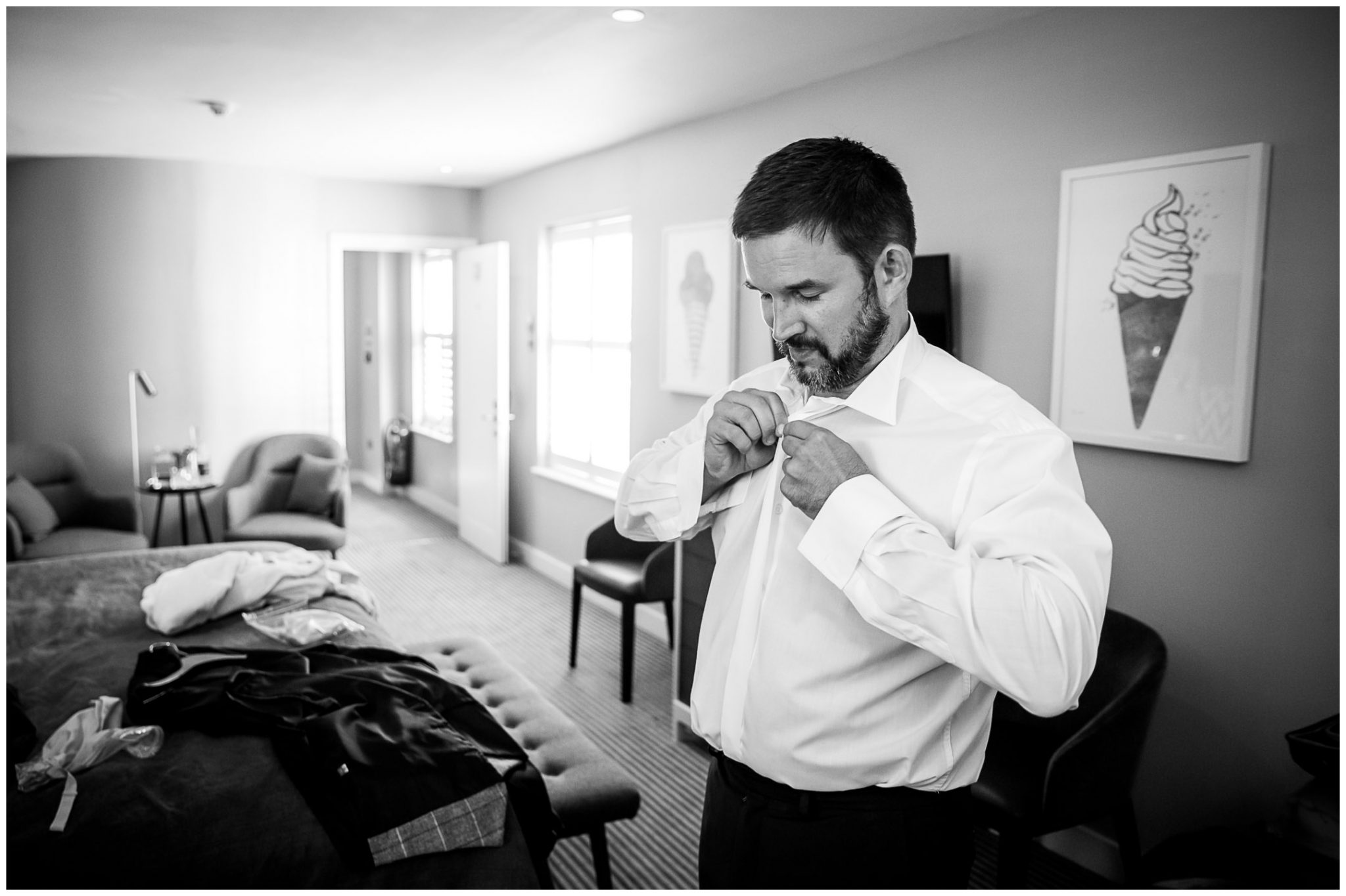 The groom getting dressed