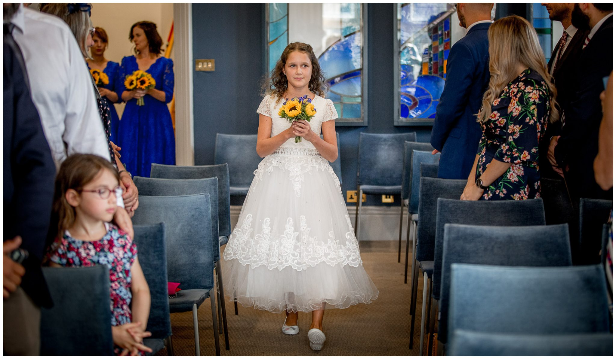 The flower girl walks down the aisle