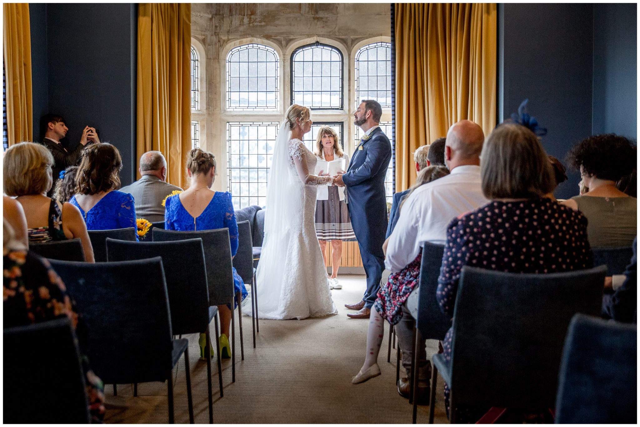 The couple turn to face each other to make their vows in front of the window in the Castle Room at Winchester Registry Office