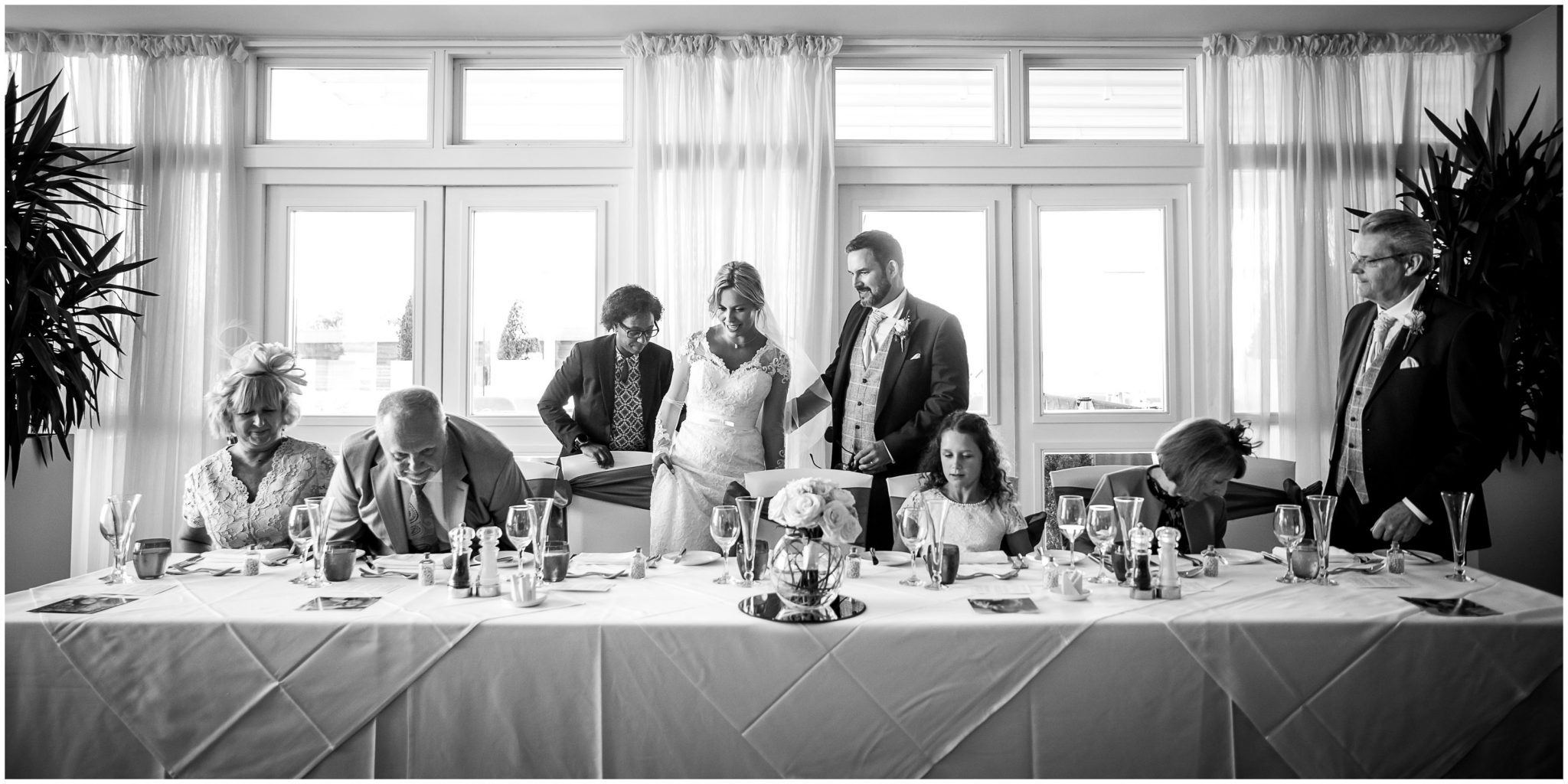 The bride takes her seat tat the top table