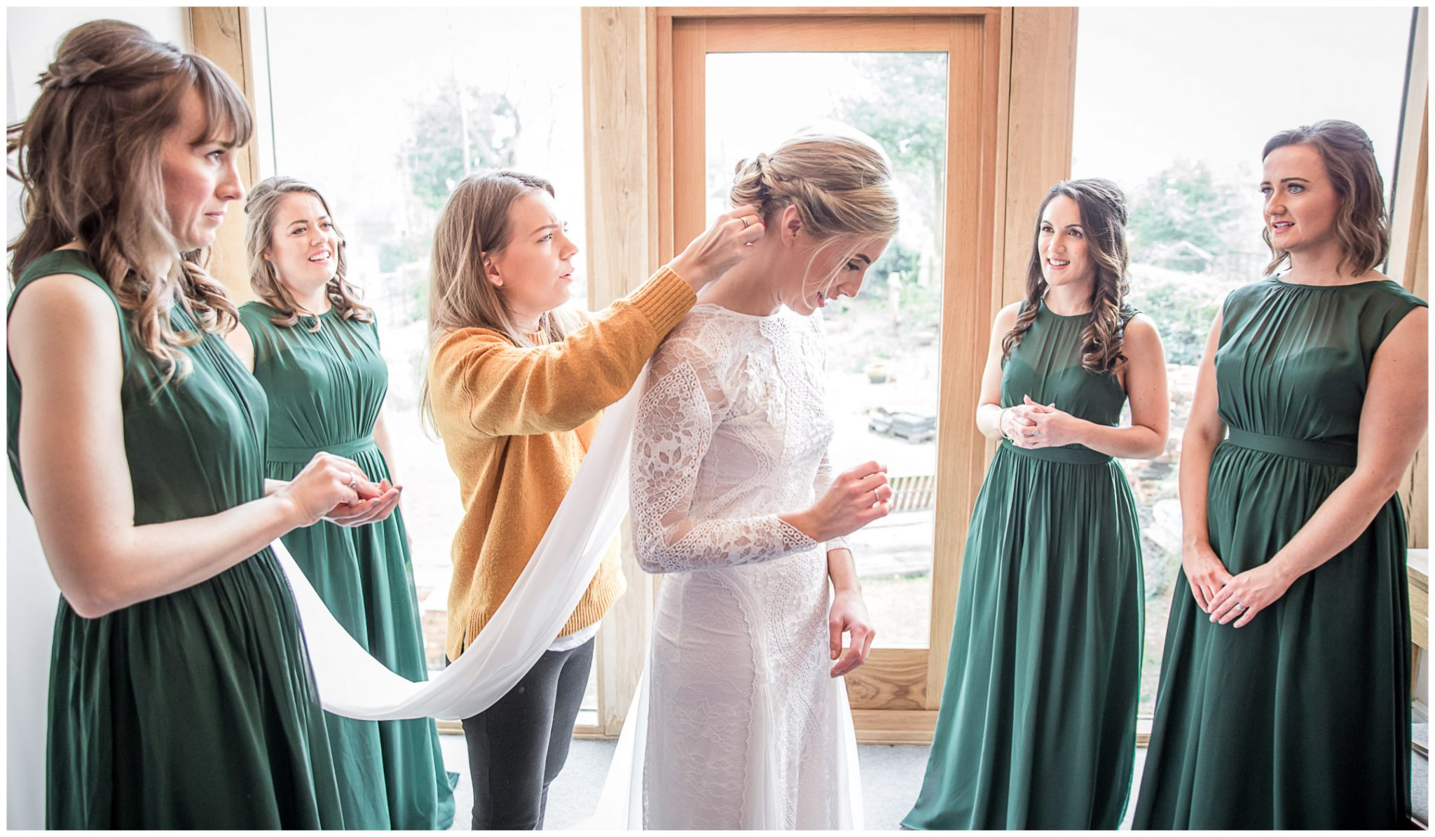 The hairdresser fixes the veil into the bride's hair