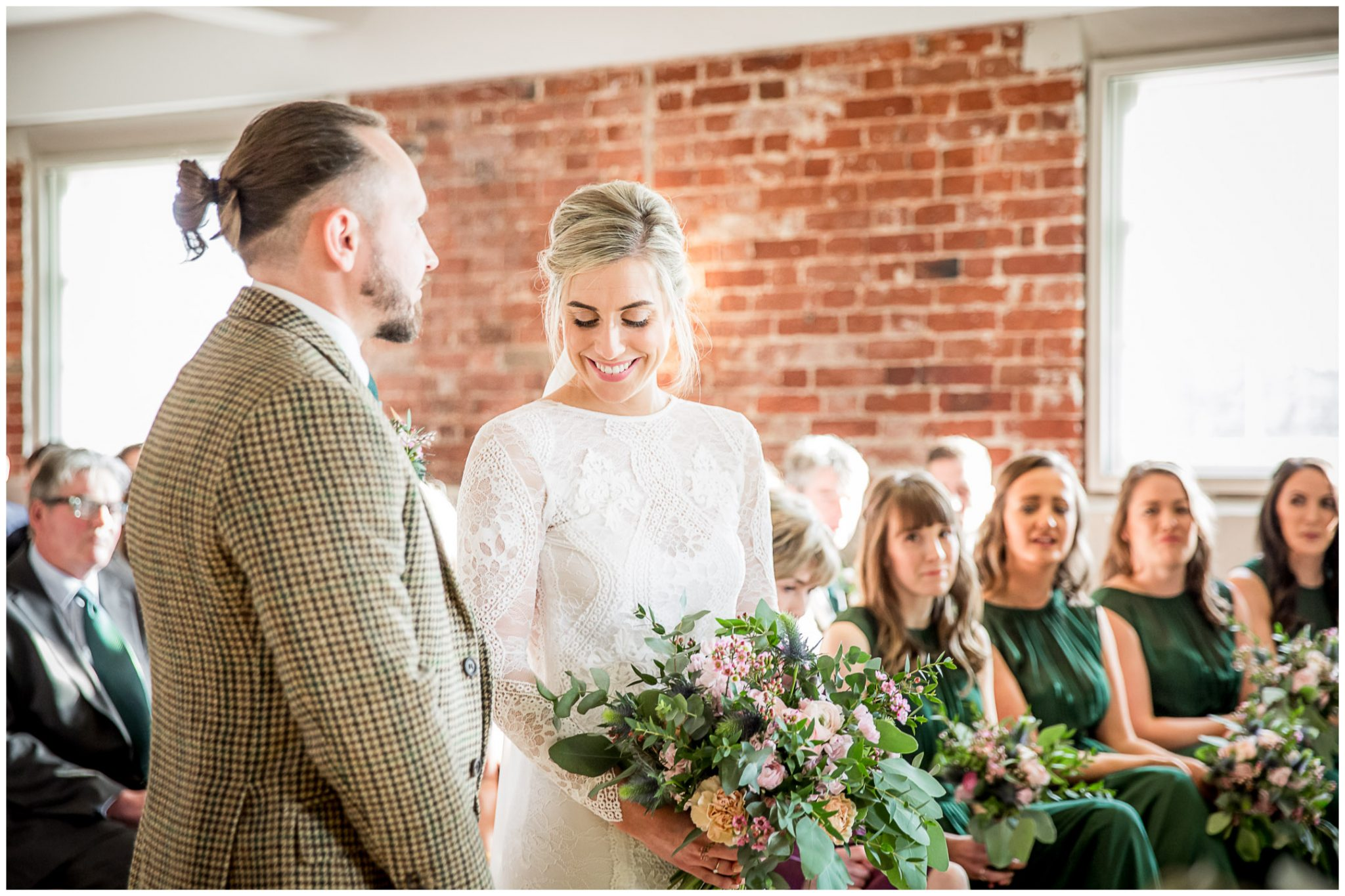 The bride and groom meet and see each other for the first time at the end of the aisle