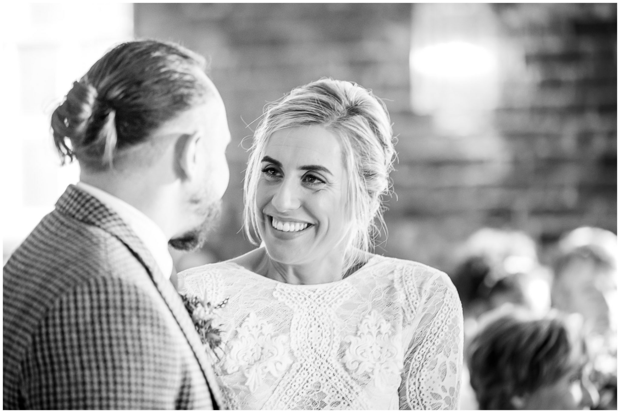 Bride and groom look happily into each others' eyes at the start of the marriage ceremony