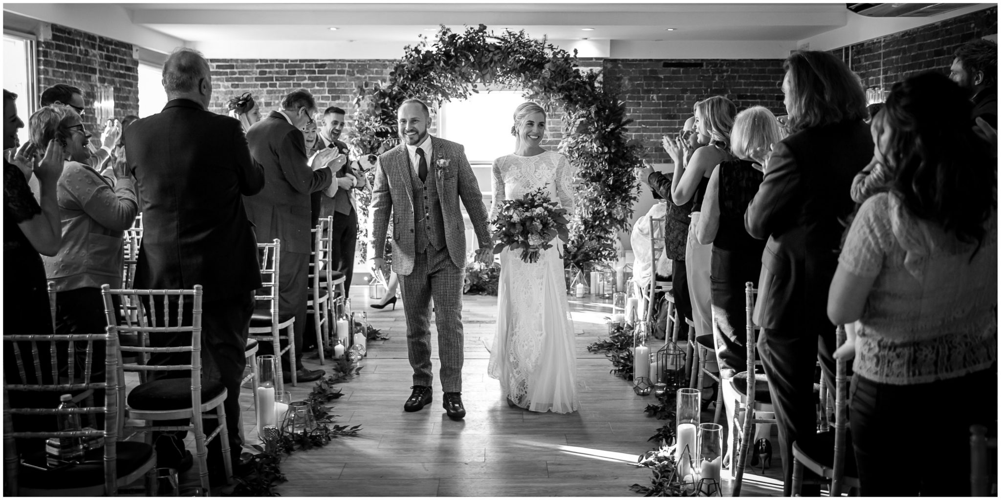 The freshly married couple walk back down the aisle as husband and wife