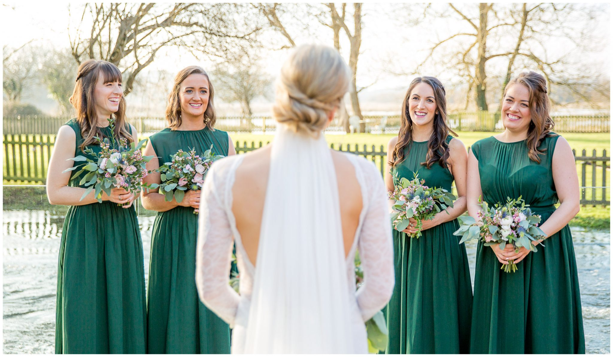 Bride and bridesmaids with the flooded river Avon as a backdrop