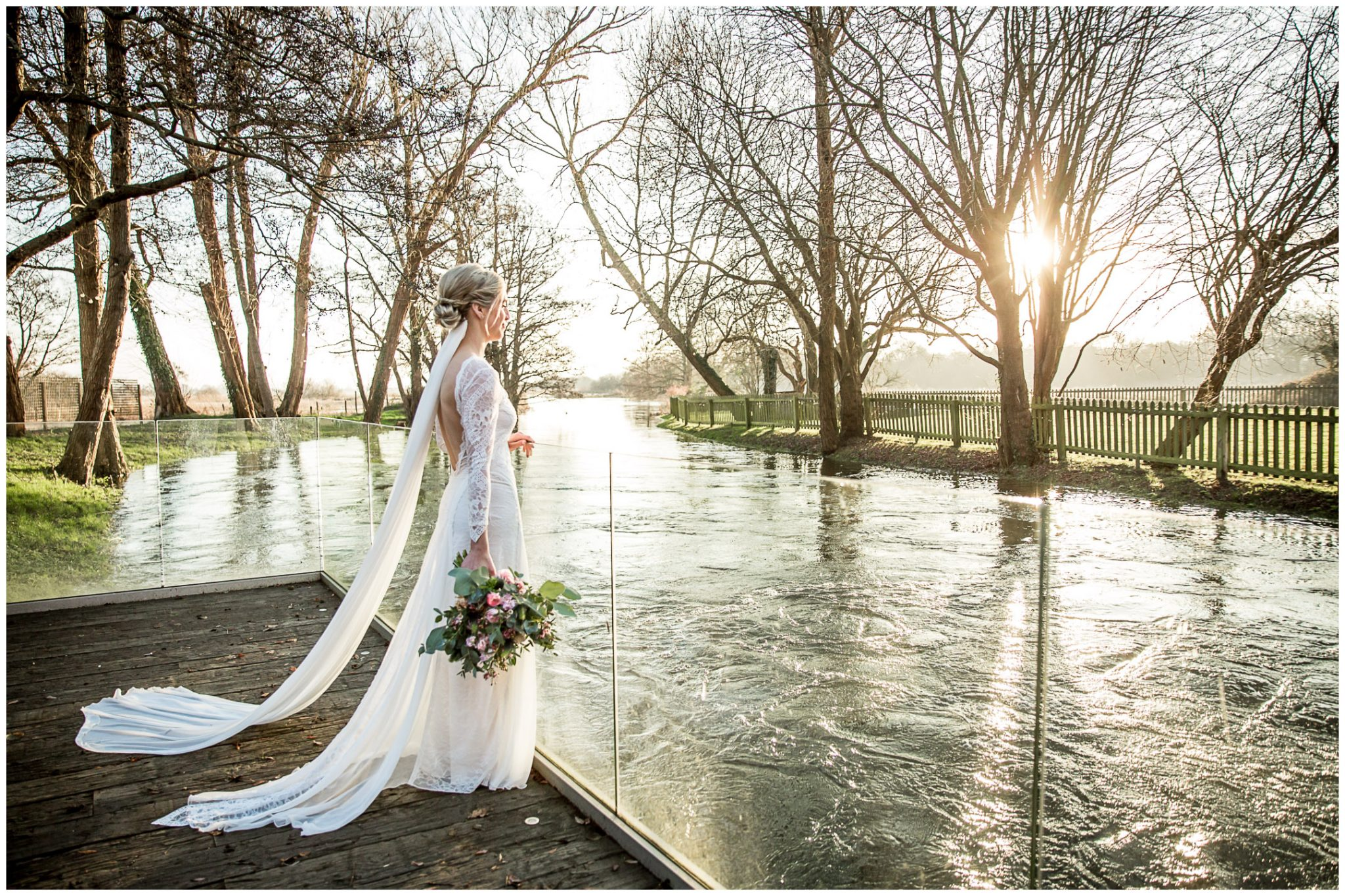 Bridal portrait looking out across the flooded river at Sopley Mill wedding venue