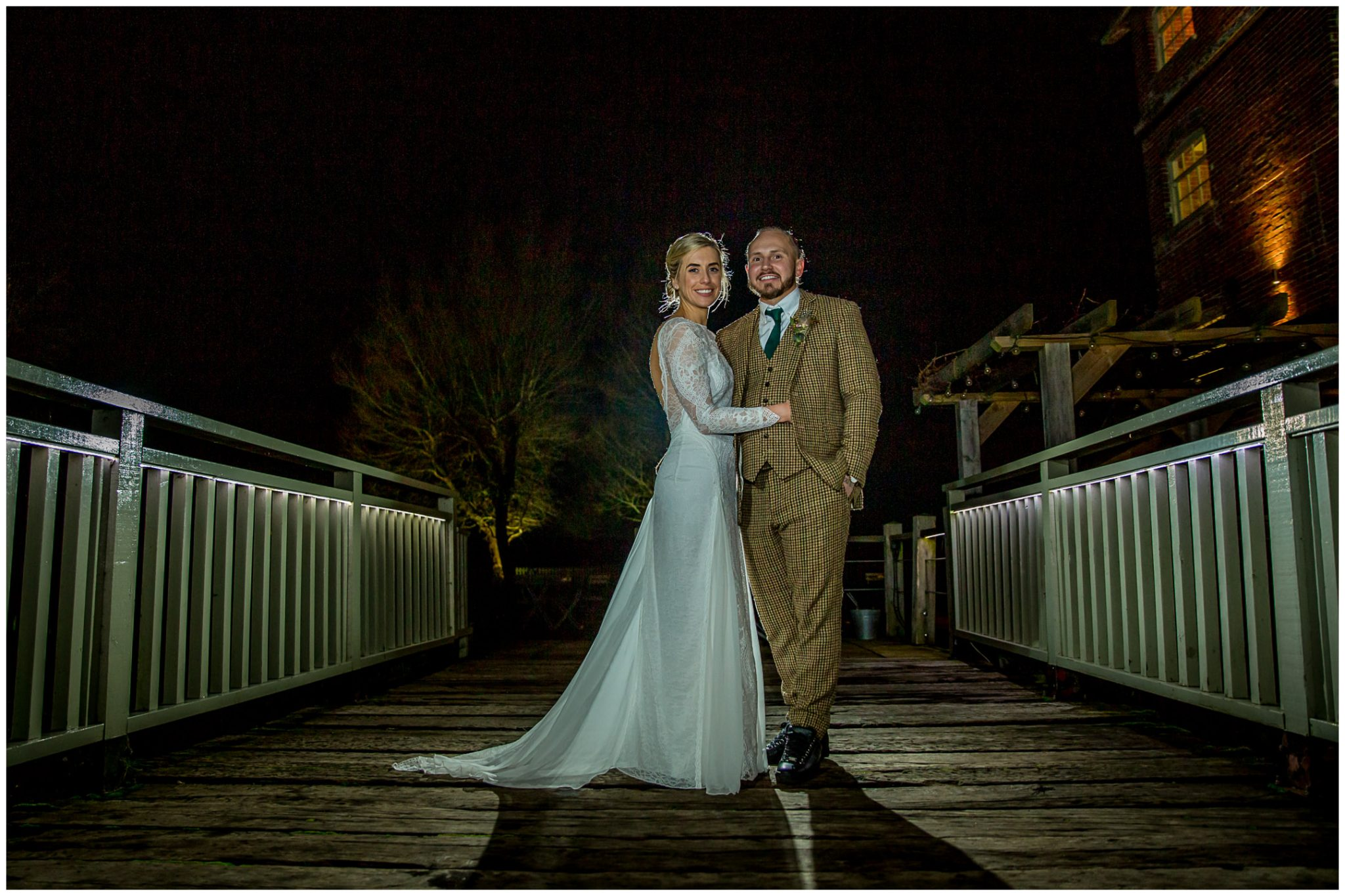 Nighttime couple portrait in the bridge at Sopley Mill