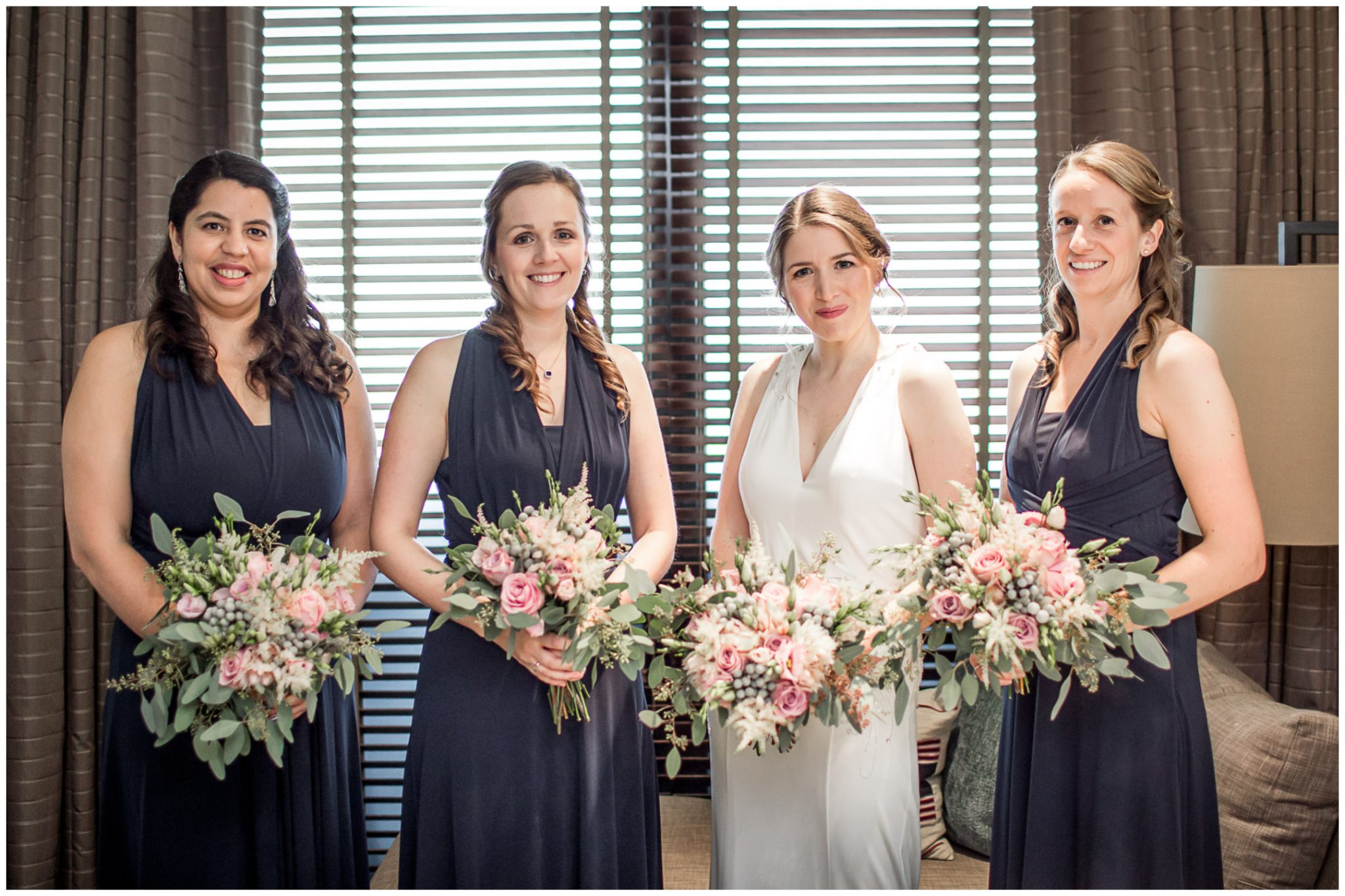 Bride with bridesmaids, dressed and ready for teh wedding