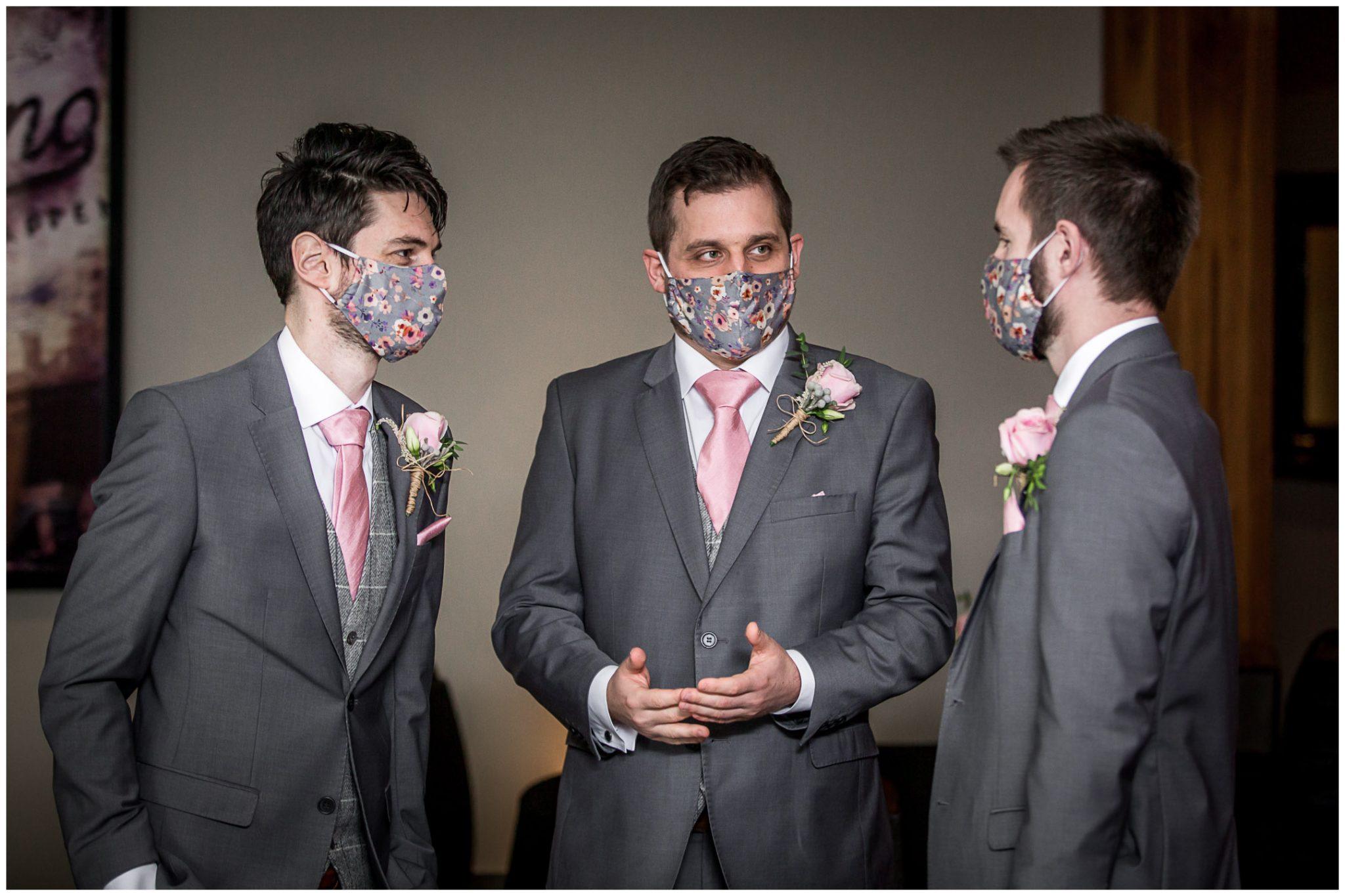 Groomsmen wearing covid masks
