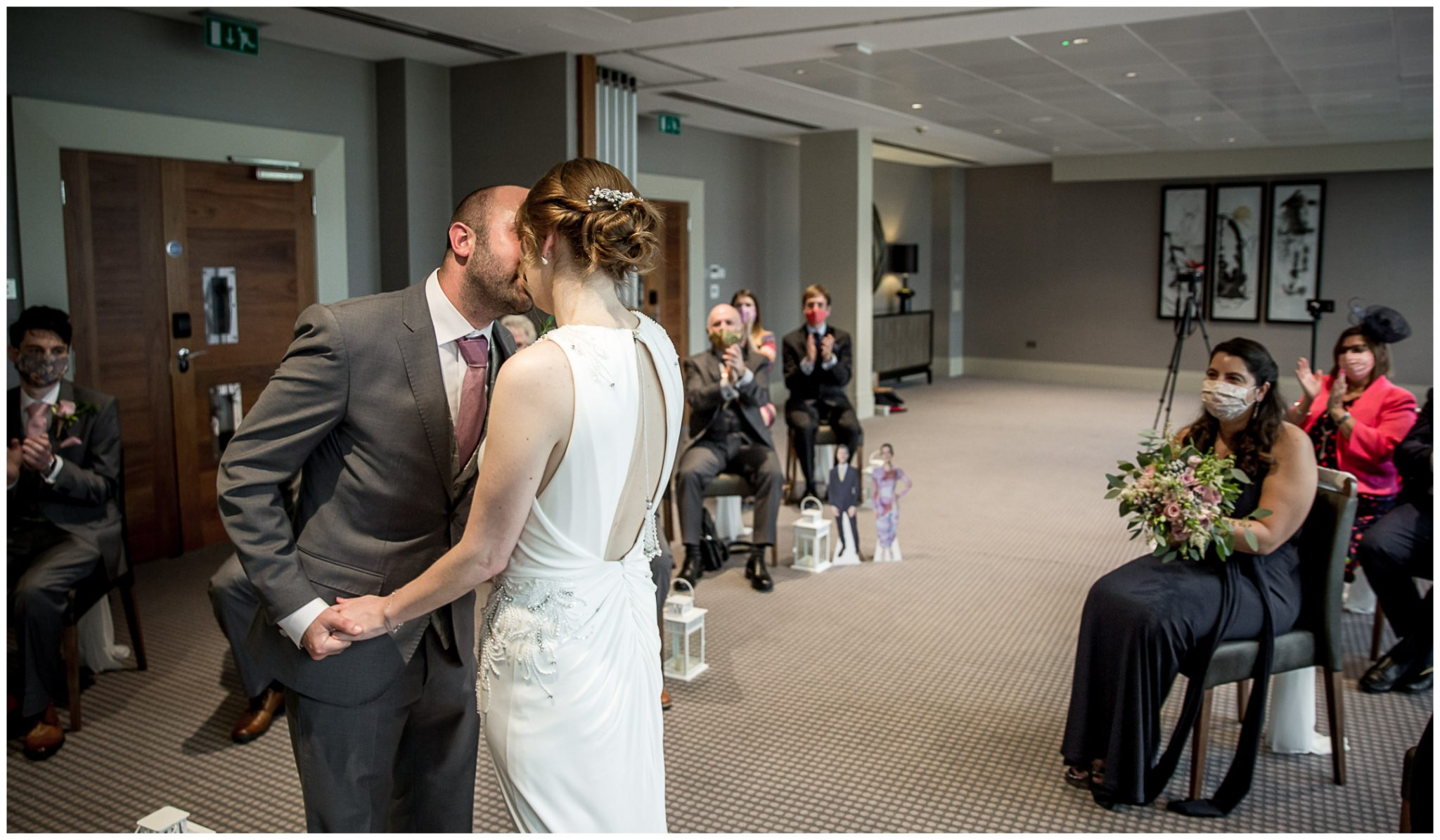 The newly married couple's first kiss as husband and wife