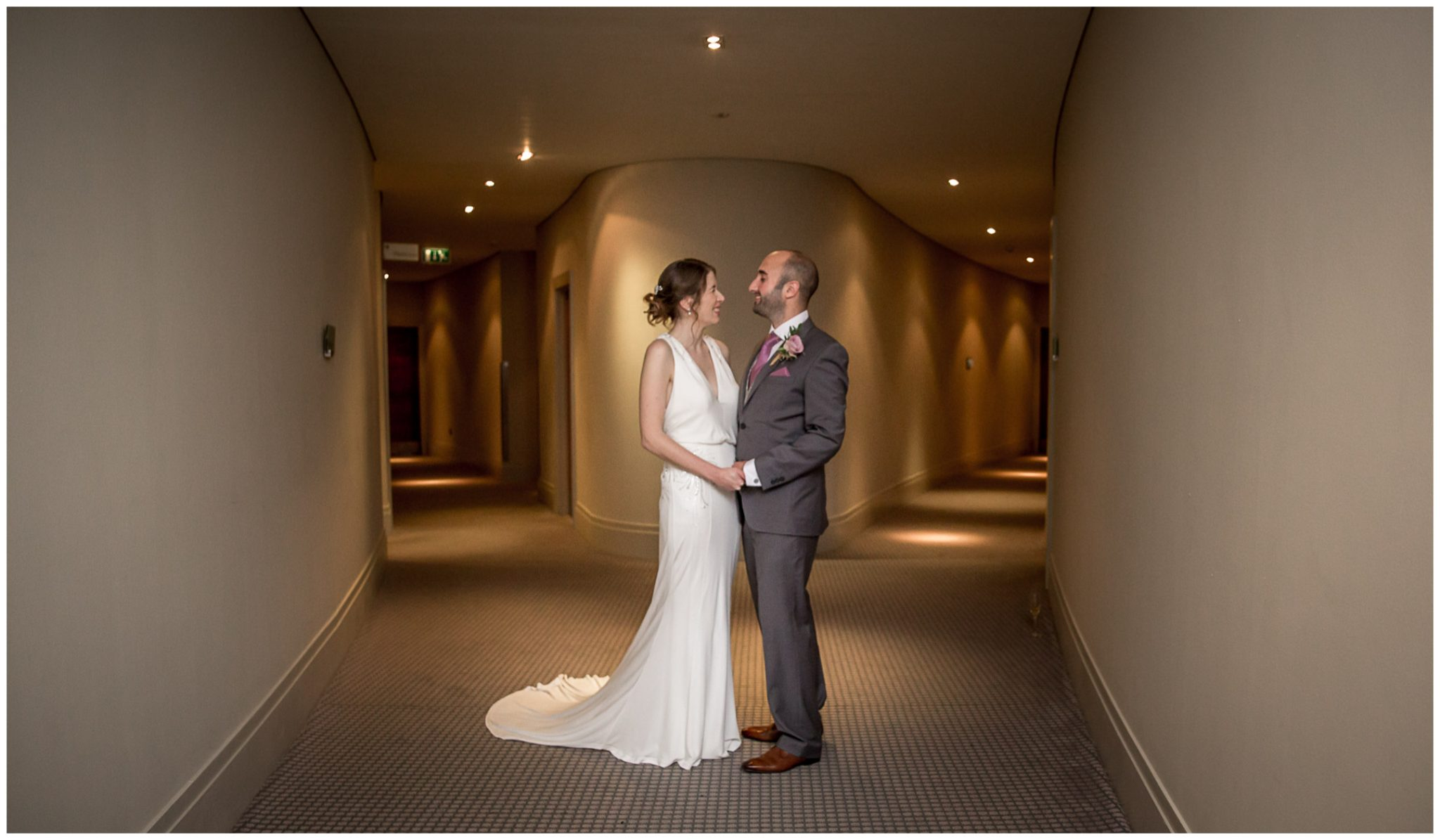 Couple portraits in the modern hotel interior corridors