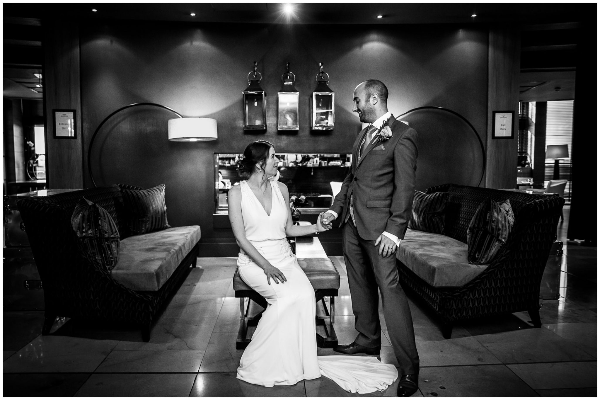 Black and white couple portrait in the artistic hotel lobby