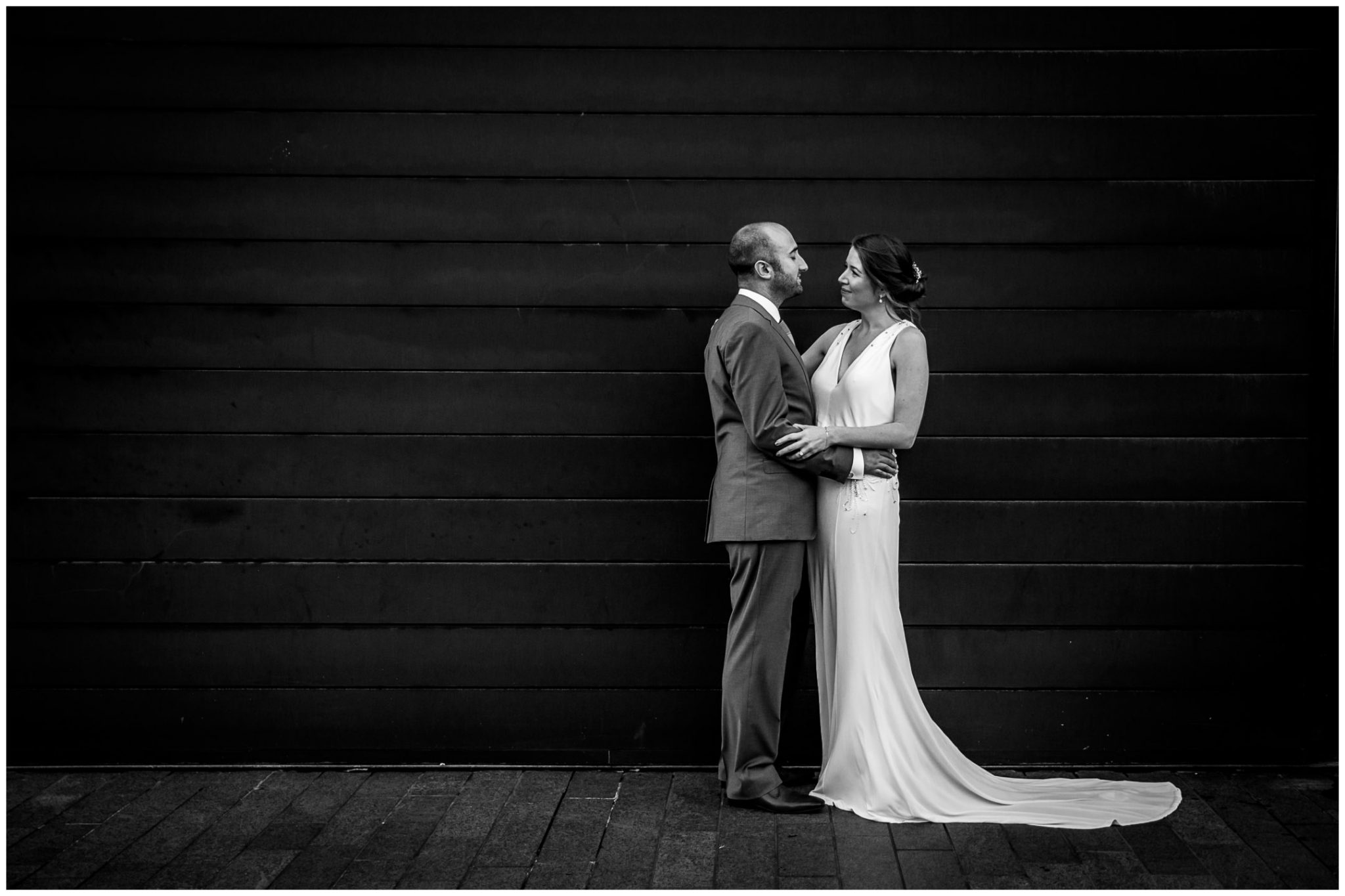 Black and white couple portrait hotel exterior