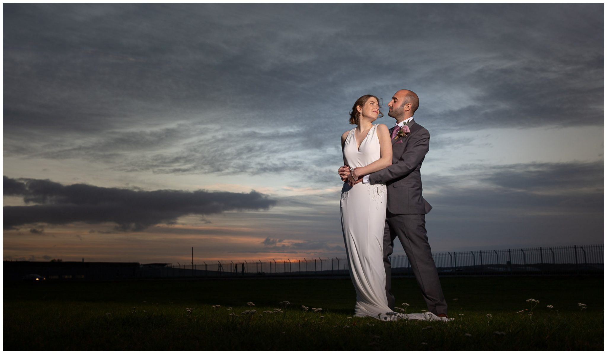 Dramatic lighting couple portrait at sunset