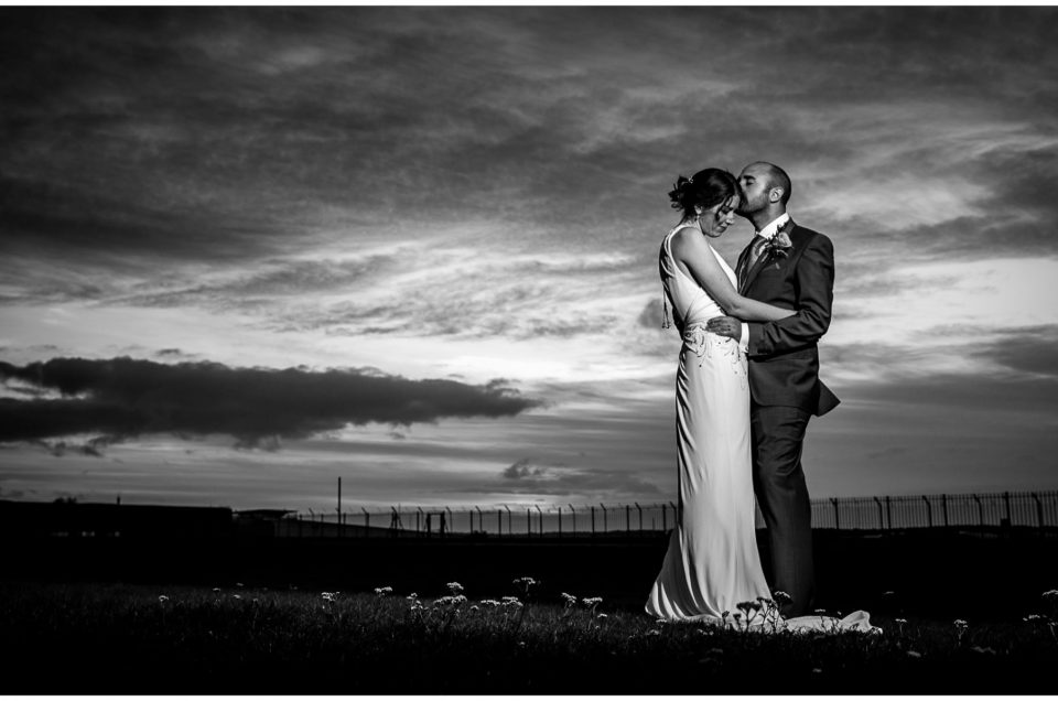 Black and white bride and groom flash lighting portrait