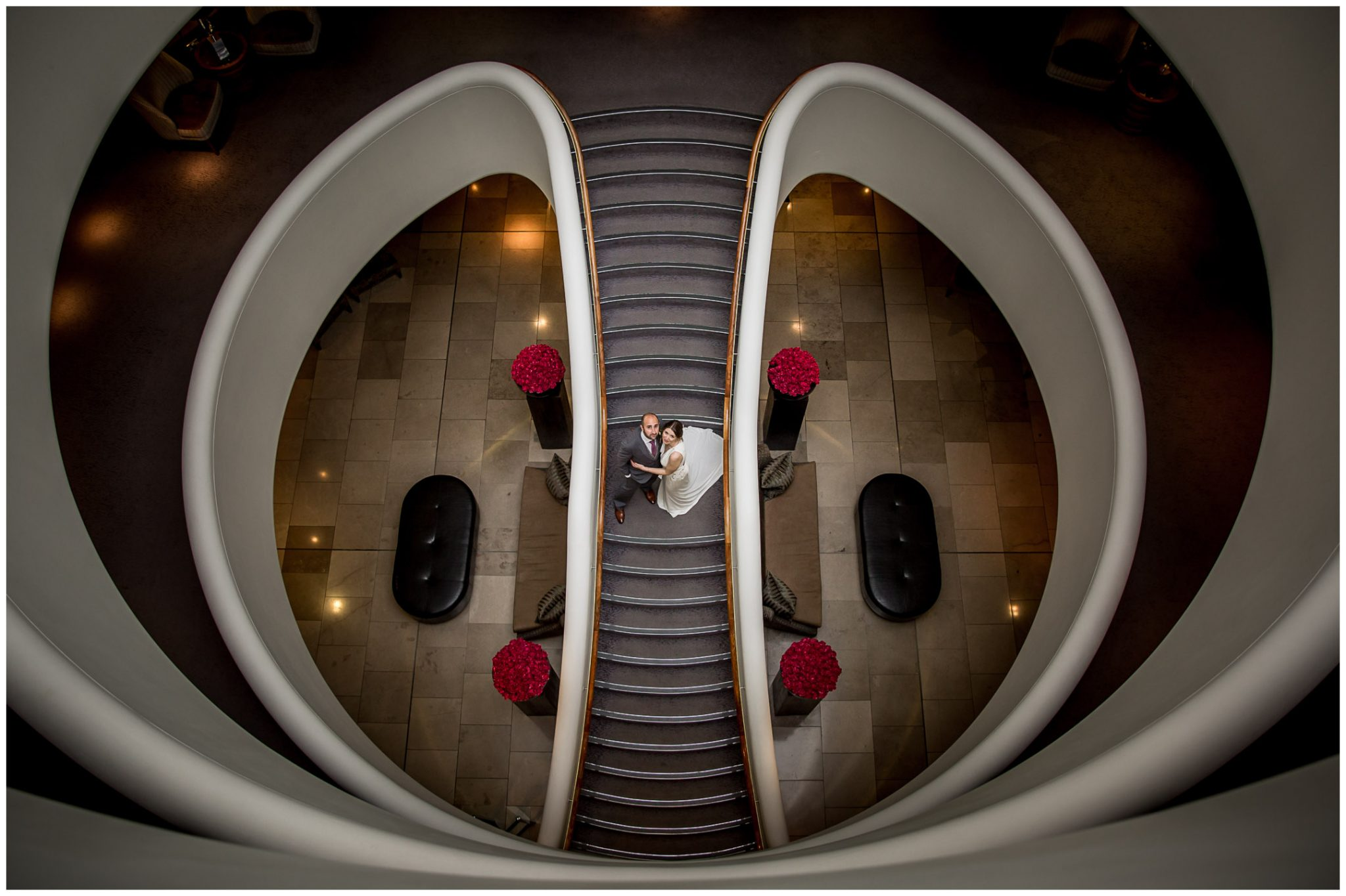 Bride and groom staircase photo at Aviator Hotel