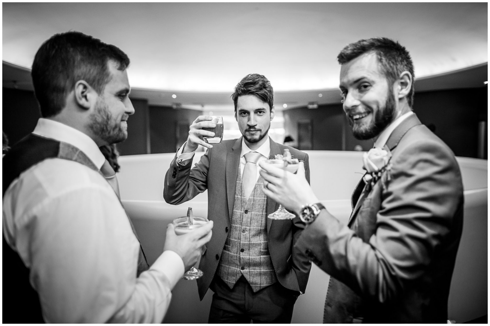 Groomsmen with cocktails at upstairs Sky Bar
