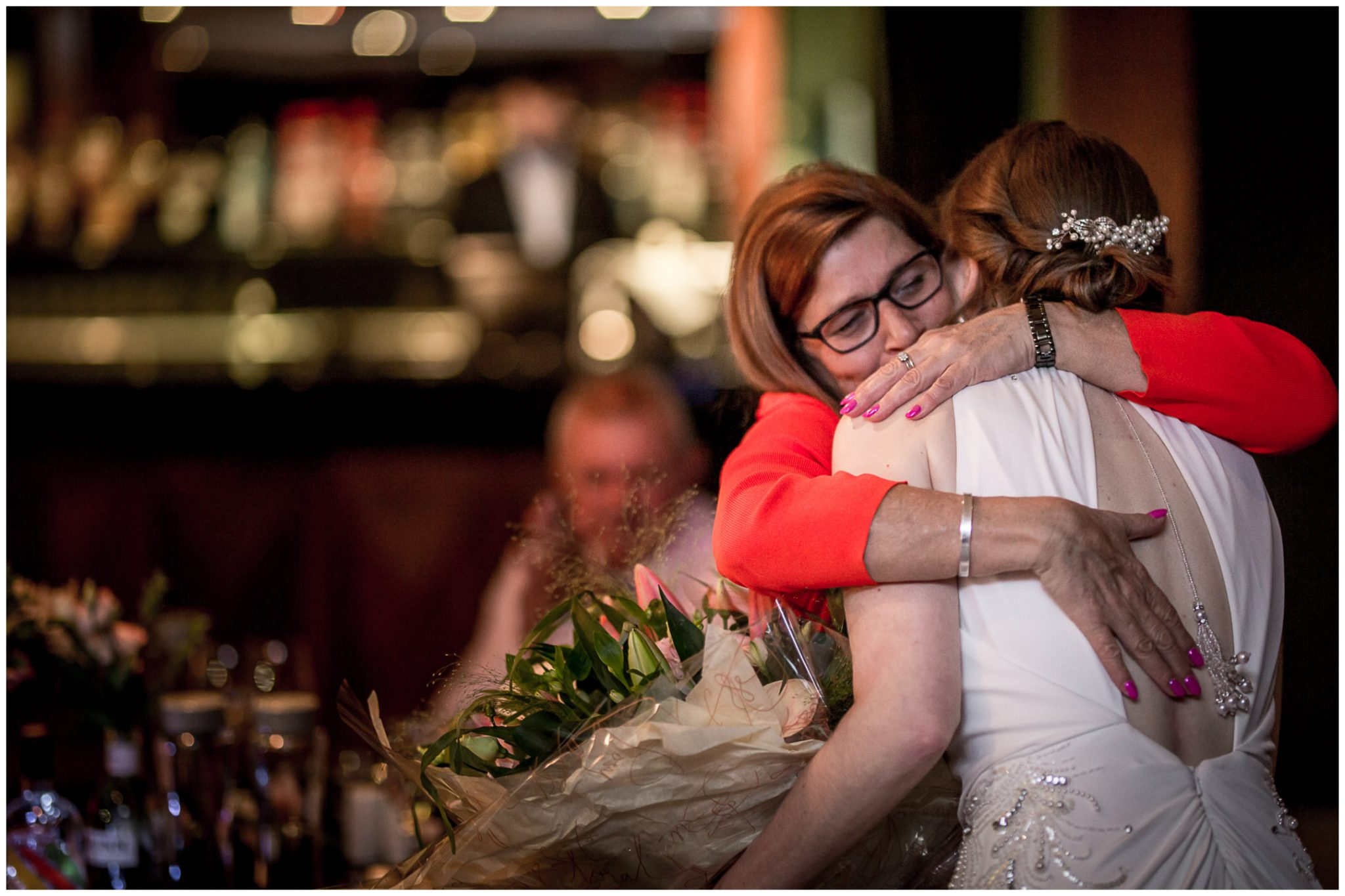 A hug for the bride during the speeches